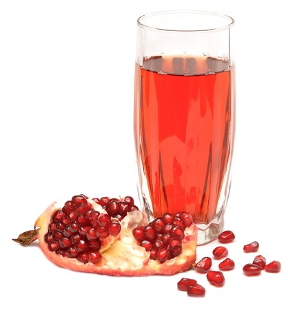 pomegranate juice in a glass isolated on a white background. photo