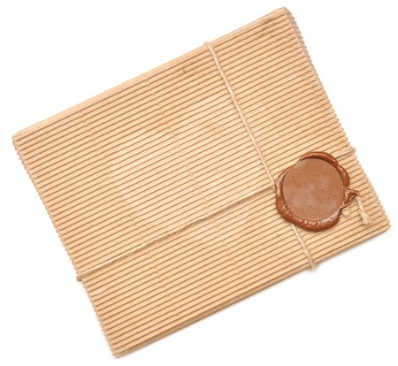 brown box with sealing wax on white photo