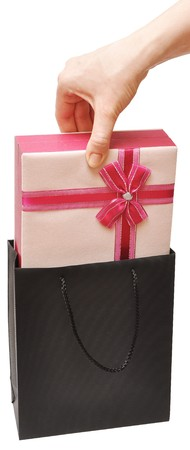 female hand with beautiful gift box in white photo