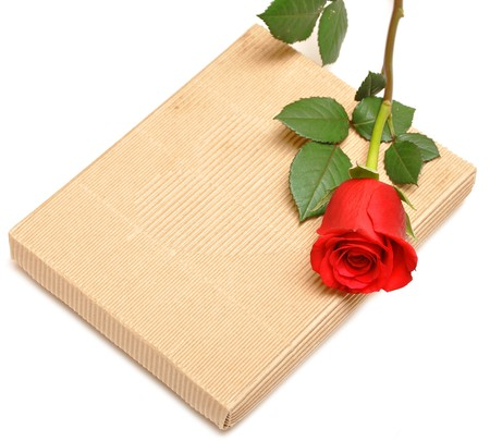 red rose and gift box on white background Stock Photo - 8229212