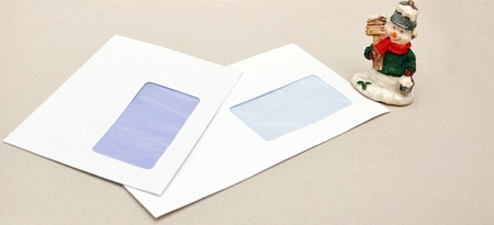 christmas toy snowman on a background of empty envelopes photo