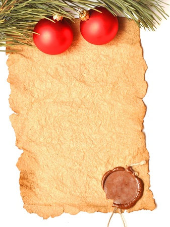 christmas red ball and old paper on pine branch photo