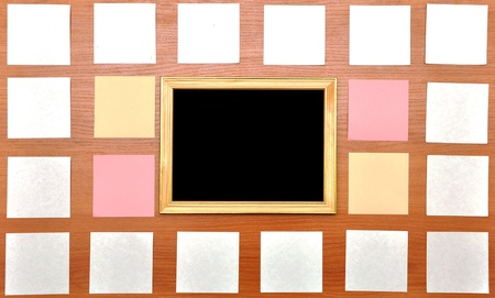 collection of white notes and frame on wood background photo
