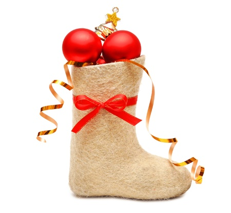 childrens boot with gifts on white photo