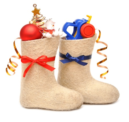 childrens boots with gifts. Blue ribbon for boys, red ribbon for girls photo