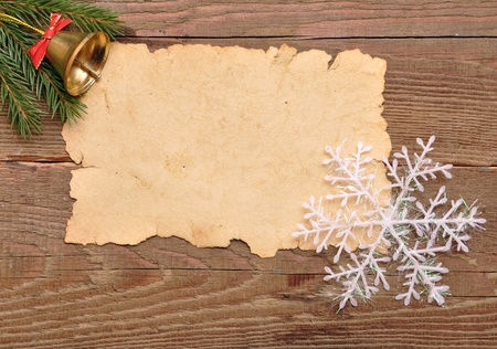christmas decoration and old paper on brown wood texture photo