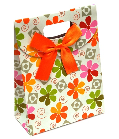 gift paper bag with bow on white background  photo