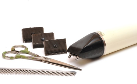 vintage set of tools for cutting hair on white photo