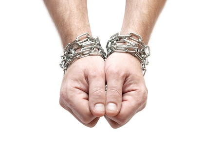 Hands chained together isolated on a white background Stock Photo - 8483693