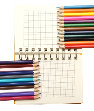blank notebook and color pencils isolated on white Stock Photo - 8483689