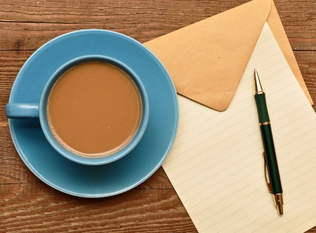 blank card on coffee cup with space for your text photo