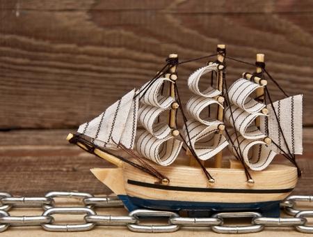 model ship on wood background Stock Photo - 8572695
