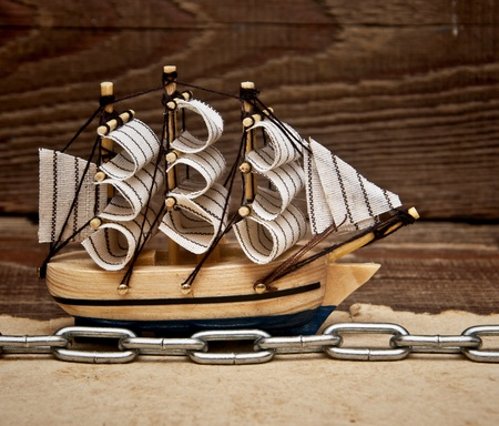 model ship on wood background Stock Photo - 8572656