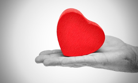 Heart in hand conceptual image photo