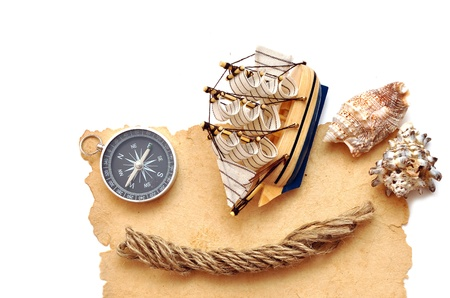 seashell, rope, compass and model classic boat on old paper Stock Photo - 8610720