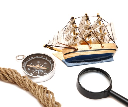 loupe, rope, compass and model classic boat on white Stock Photo - 8610701