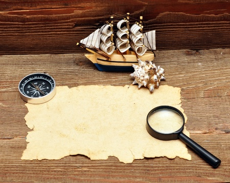 model classic boat, compass and rope on wood background Stock Photo - 8610705