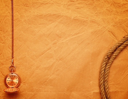 pocket watch and rope on old yellow paper  photo