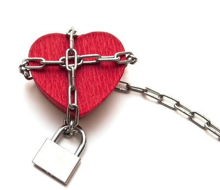 love locked heart shape with chains on white photo