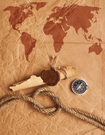 scroll with wax seal and rope on old paper background photo