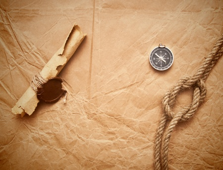 credence: scroll with wax seal and rope on old paper background Stock Photo