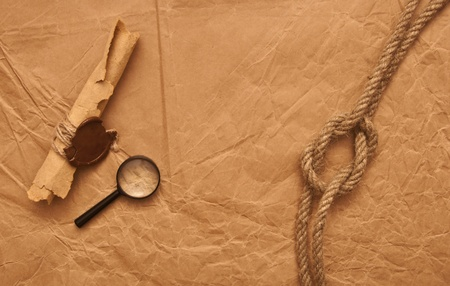 credence: scroll with wax seal and rope on old paper background