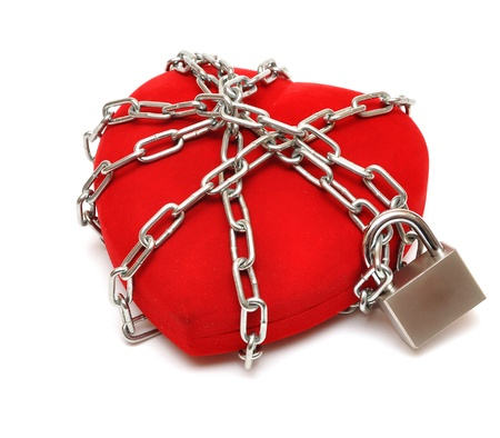 heavy heart: love locked heart shape with chains on white