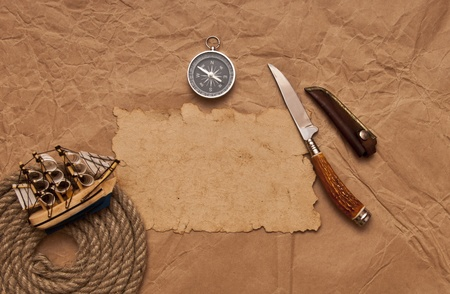 old paper, rope coil, compass, decorative knife and model classic boat photo