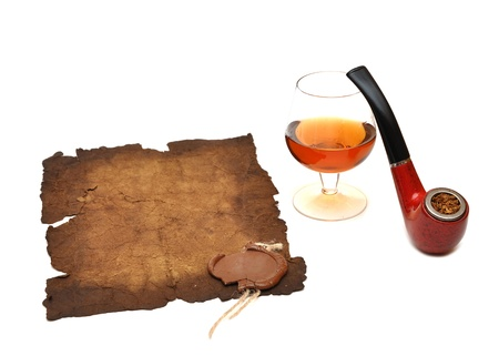 old paper seal wax , pipe and glass of cognac on white photo