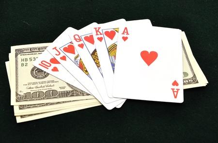 Royal flush from the poker cards on  green felt photo