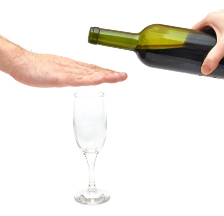 abusive man: hand over glass - stop alcoholism concept  Stock Photo