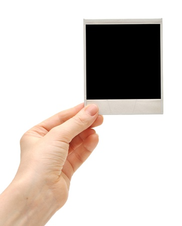 instant camera: one instant photo in hand isolated on white background Stock Photo
