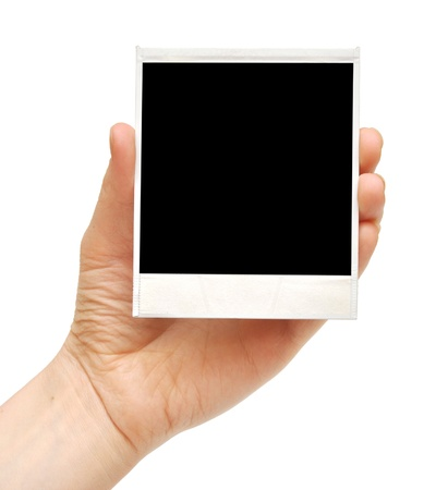 hand holding paper: one instant photo in hand isolated on white background Stock Photo