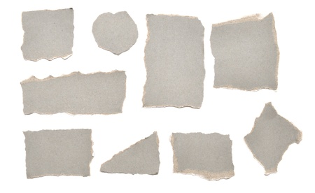 collection of grey ripped pieces of paper on white background photo