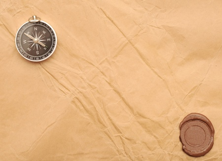 seal wax and compass on old paper background photo