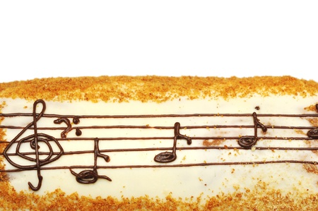 appetizing cake with treble clef drawing by cream photo