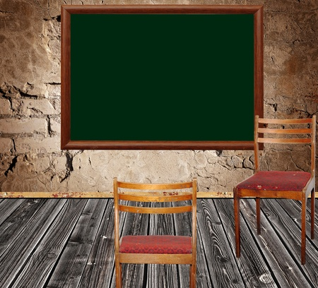 photo of abstract grunge shabby interior with school blackboard and two chairs photo
