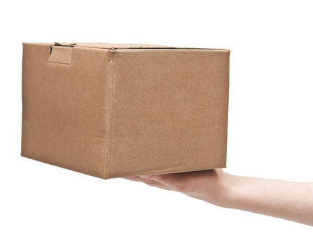 packer: mans hand with cardboard box on white background Stock Photo