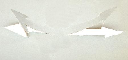the arrow pierced the gray cardboard photo