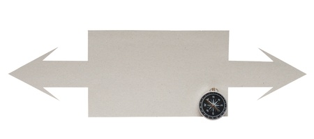 Cardboard navigation arrows with compass on a white background  photo
