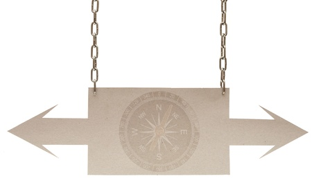 Cardboard navigation arrows on a white background photo