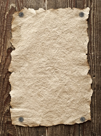 the western wall: Old paper tacked to a wood wall Stock Photo