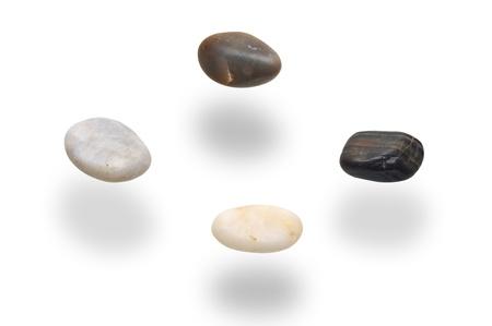 levitacion: levitation stones over white