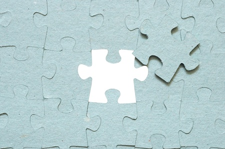Grey puzzle with missing piece  photo