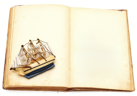 old book and ship on white background photo