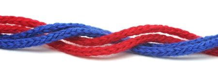 bonding rope: red and blue synthetic ropes isolated on white background Stock Photo