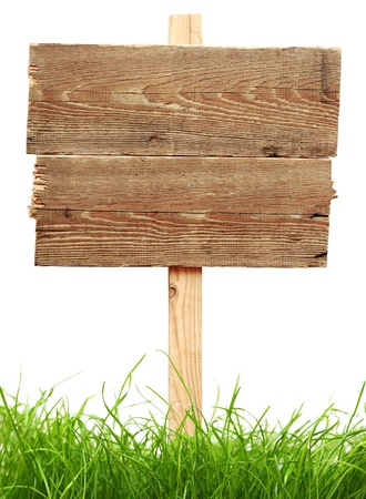 wooden signboard: road sign with green grass isolated on a white background  Stock Photo