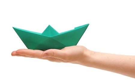 paper ship in a female hand on white Stock Photo - 9330990