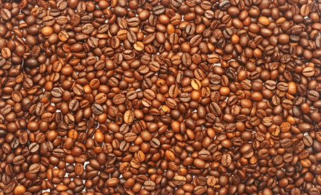 Fresh roasted brown aromatic coffee beans background photo