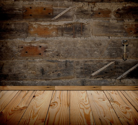 Old grunge room with vintage key on wooden wall  photo